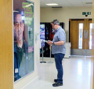 Boots poster with leaflet dispenser in NHS trust