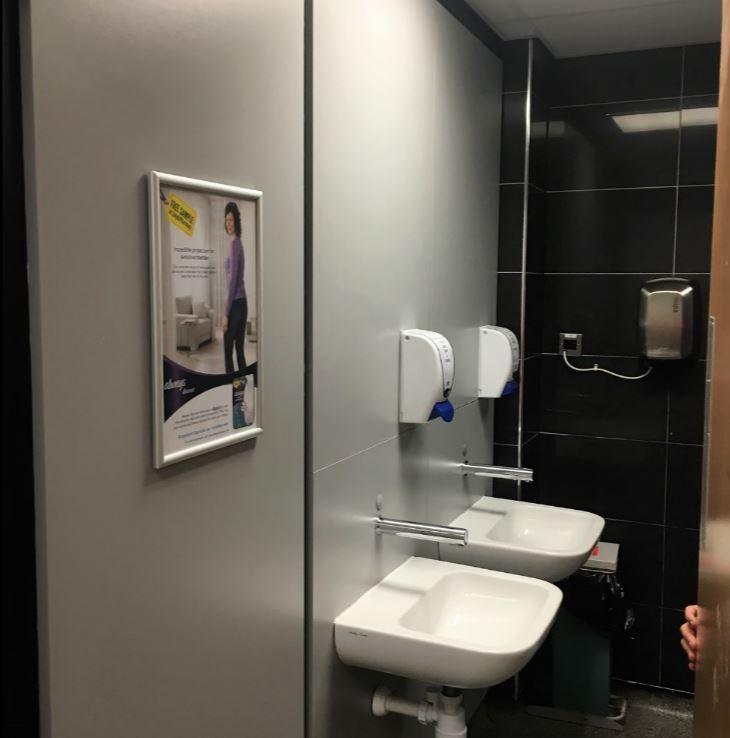 Washroom advertising in hospitals