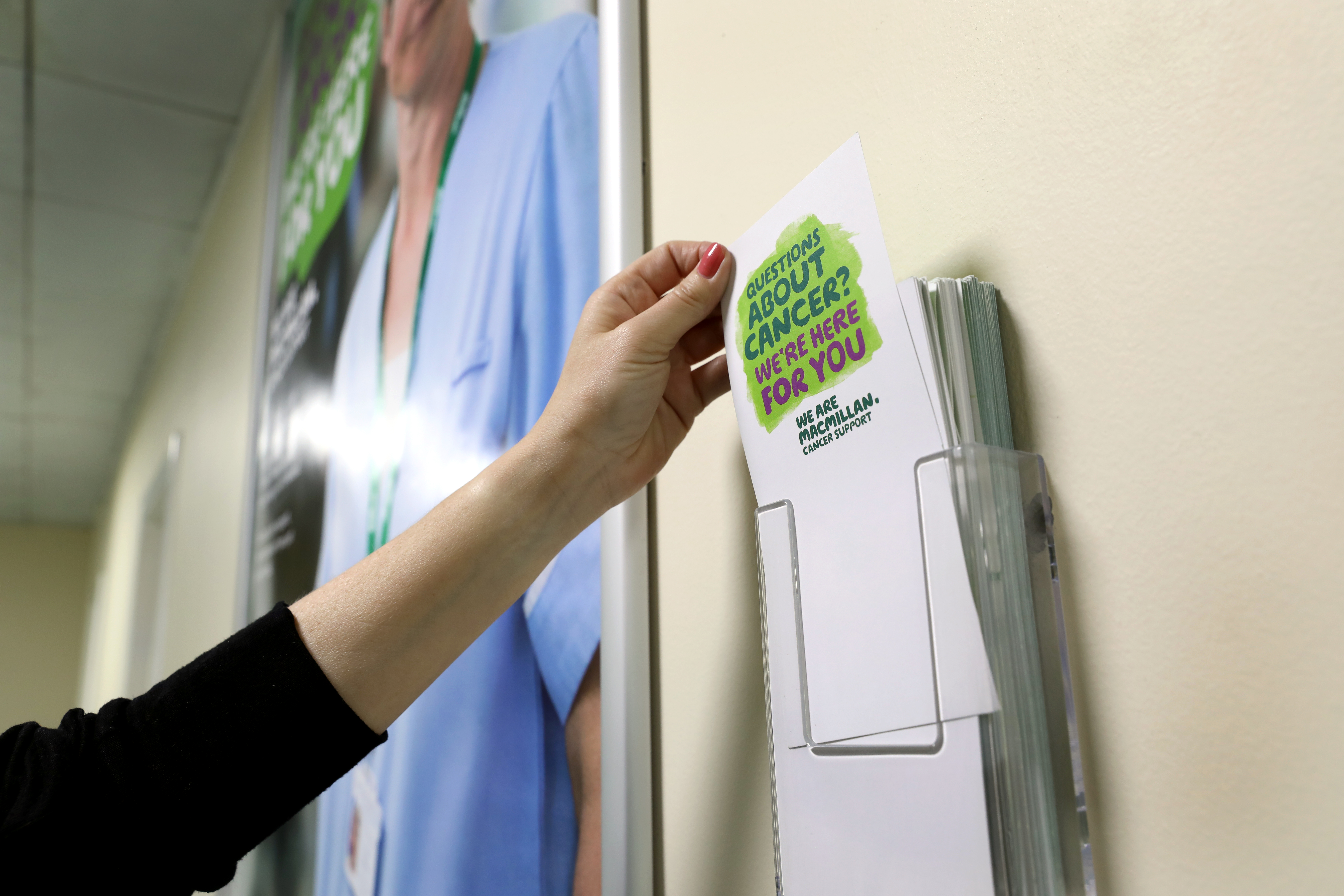 Macmillan poster advertising to patients with leaflet dispenser
